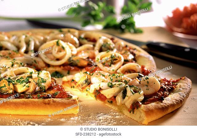 Pizza with seafood (a piece cut)