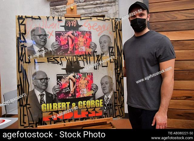 The street artist Endless with the self-portrait with Gilbert & George donated to the Uffizi Gallery , Florence, ITALY-08-02-2021