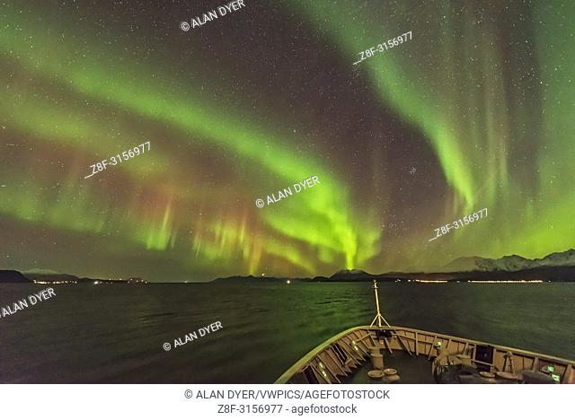 The Northern Lights exhibiting the classic red colour in the upper curtains in addition from the main green lower curtains, with both colours from oxygen