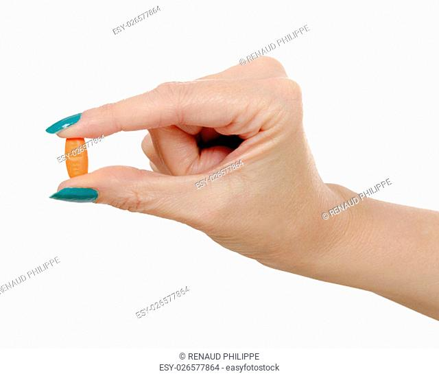 woman hand and orange pill isolated on white background