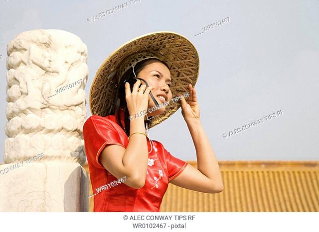 China, Beijing, the Forbidden City, asian woman on mobile