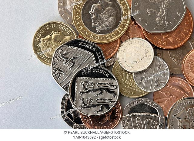 Pile of UK sterling coins in various denominations