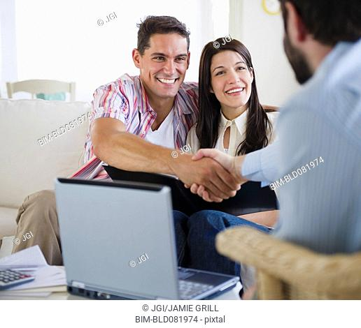 Couple greeting finance advisor