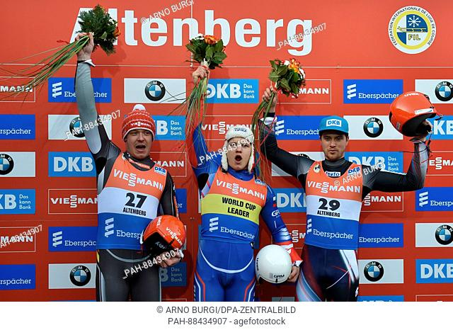 Felix Loch (L-R, 2nd place - Germany), Roman Repilov (1st place - Russia) and Johannes Ludwig (3rd place - Germany) celebrate their placement after the men's...