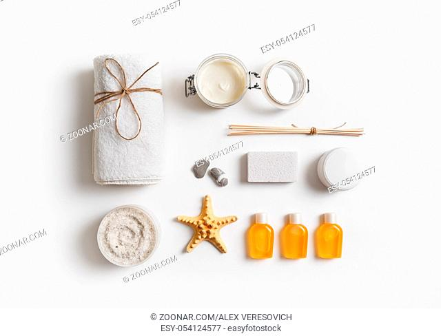 Spa and beauty threatment products on white paper background. Spa branding mock-up. Flat lay