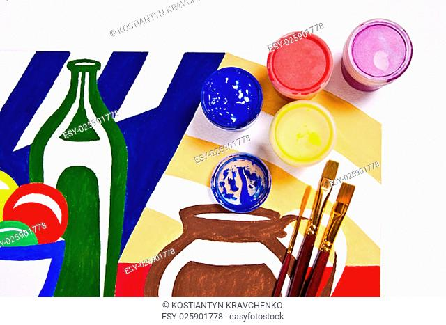 Bottles with gouache paints and different kinds of brushes for artistic paintings.Original artistic painting of still life on the background
