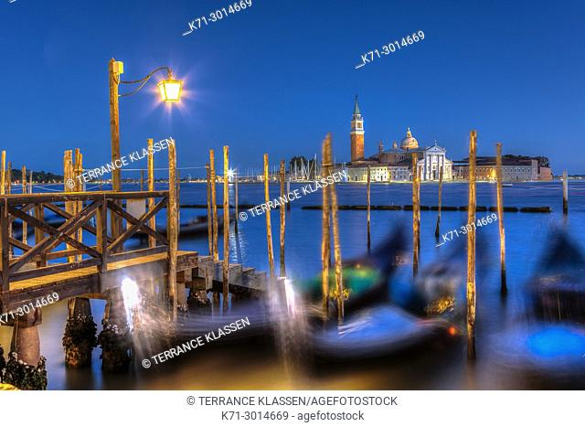 An evenng view of gondolas and theChurch of San Giorgio Maggiore in Veneto, Venice, Italy, Europe,