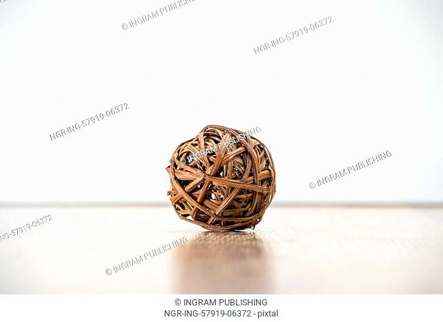 Tangled single wooden old knot sphere. Depression and crisis concept