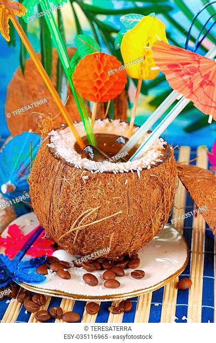 iced coffee served in coconut shell on tropical beach