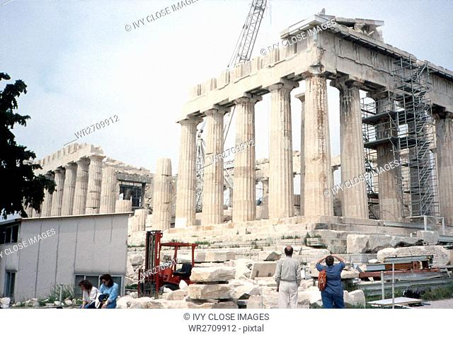 This photo, taken around 1990, shows a front view of the Acropolis in Athens, Greece. The Acropolis in Athens, Greece, is an outcrop of rock used in ancient...