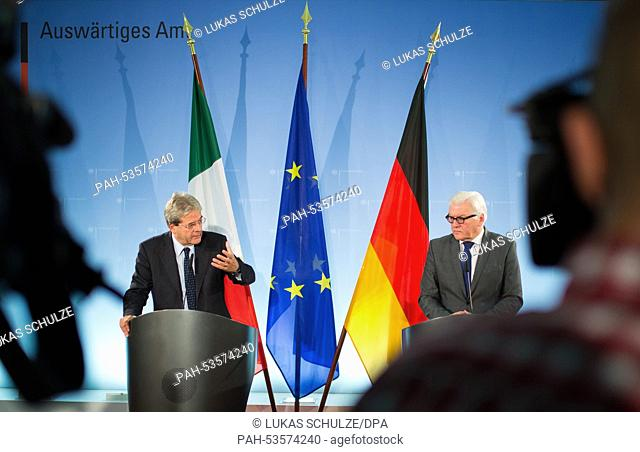 Italian Foreign Minister Paolo Gentiloni (L) and German Foreign Minister Frank-Walter Steinmeier (SPD) talk about immigration during a press conference in...