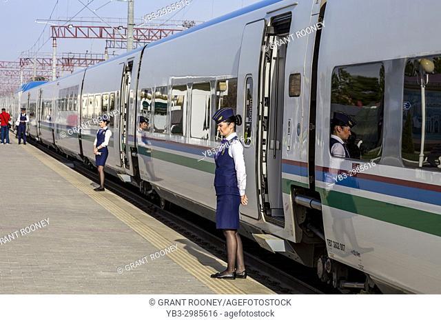 Female Ticket Inspectors Standing Outside The Afrosiyob High Speed Train, Bukhara Railway Station, Bukhara, Uzbekistan