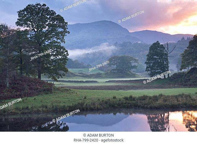 Atmospheric autumn sunset from the River Brathay near Elterwater, Lake District, Cumbria, England, United Kingdom, Europe