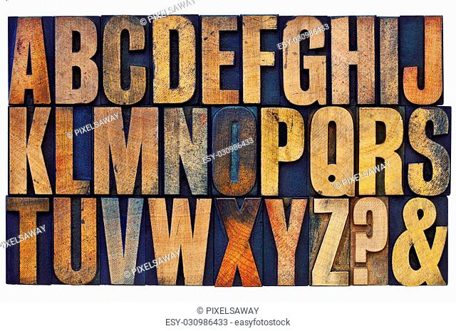 26 letters of English alphabet, question mark and ampersand - vintage letterpress wood type printing blocks stained by color inks