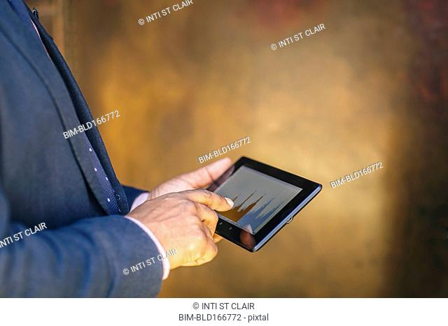Mixed race businessman using digital tablet