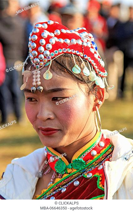 Chinese woman in ancient Chinese clothing during the Heqing Qifeng Pear Flower festival, China