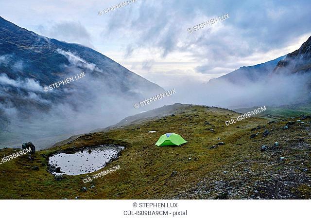Mountain view with tent on hill, Ventilla, La Paz, Bolivia, South America