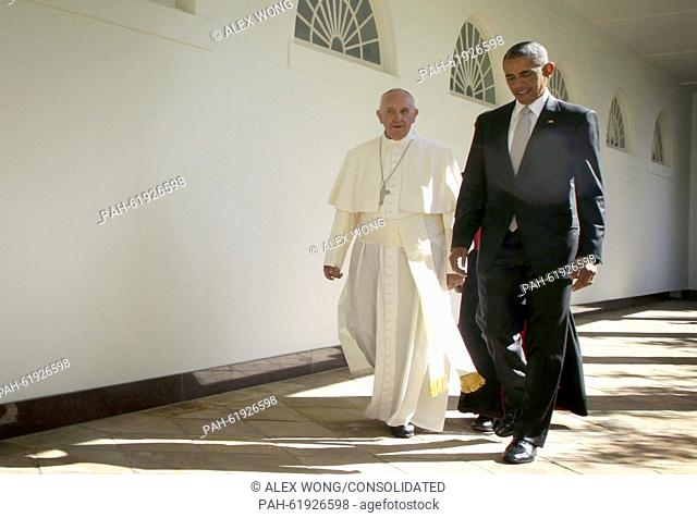 U.S. President Barack Obama (R) and Pope Francis (L) walk through the colonnade prior to an Oval Office meeting at the White House on September 23