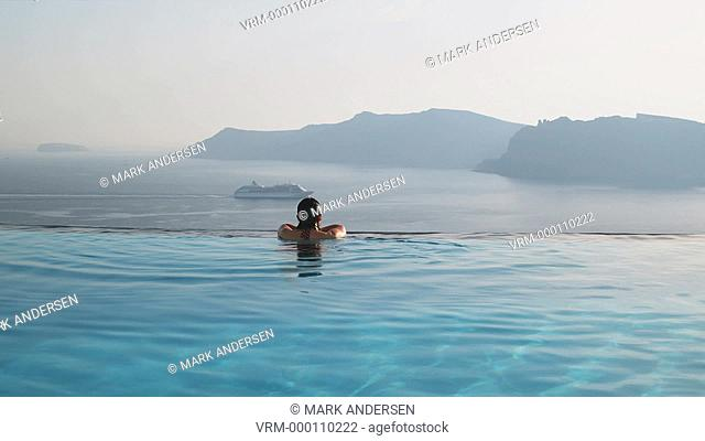 woman in an infinity pool