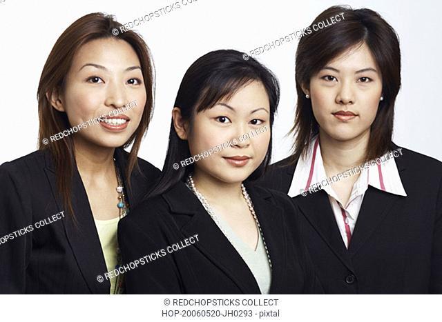 Portrait of three businesswomen smiling