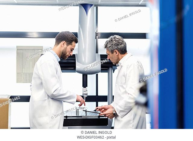 Engineers checking a machine