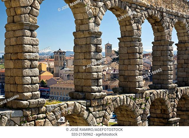 San justo and Salvador churchs behind Acueducto in Segovia. Castilla Leon. Spain