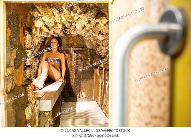 women in stove (natural sauna). Caldes de Boi Spa, Boí valley. Lleida province. Catalonia. Spain