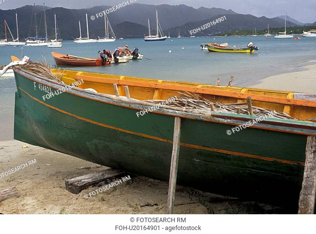 Martinique, Caribbean, Caribbean Islands, Green fishing boat beached on the shore in Ste. Anne on the island of Martinique (a french department)