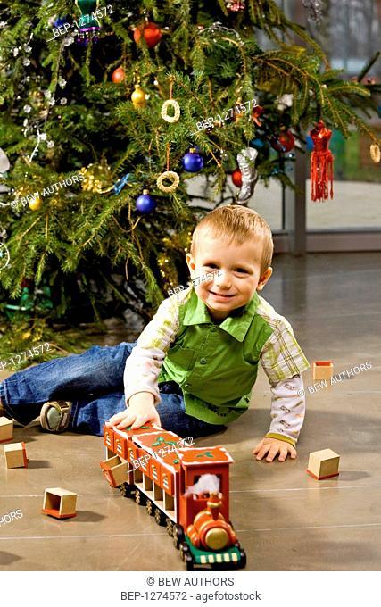 Boy enjoying his Christmas present