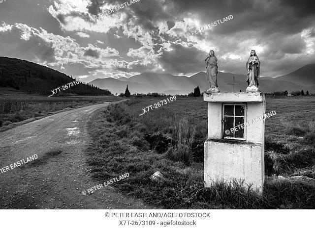 Roadside shrine on the plain of Mantineia, near Tripoli, Southern Arcadia, Peloponnese, Greece