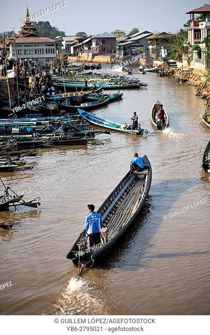 Traditional taxi boats along a water canal in Nyaungshwe, Inle Lake, Myanmar