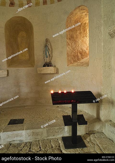 candles under a window, Church of Saint Peter, Monbos, Dordogne, Department, Nouvelle-Aquitaine, France