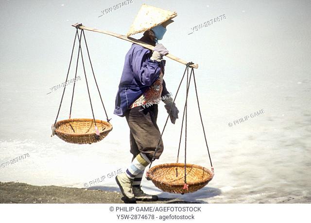 Woman harvesting salt at Cam Ranh Bay, central Vietnam