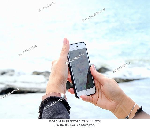 Pomorie, Bulgaria - October 06, 2018: Photo of a woman using smart phone