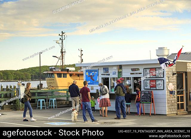 People waiting at Lobster and clam shack at ocean-front harbor, Castine, Maine, New England, USA
