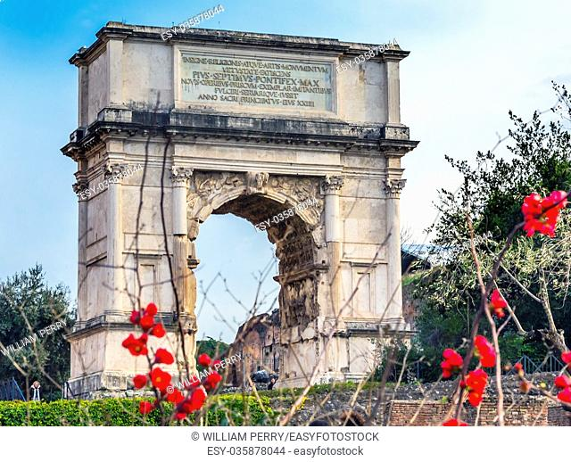 Titus Arch Red Flowers Roman Forum Rome Italy. Stone arch was erected in 81 AD in honor of Emperor Vespasian and his son Titus for conqueiring Jerusalem and...