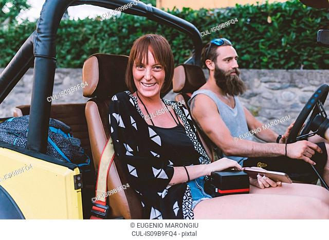 Portrait of young couple on road trip in off road vehicle, Como, Lombardy, Italy