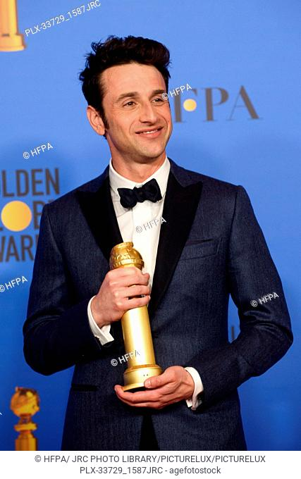 """After winning the category of BEST ORIGINAL SCORE – MOTION PICTURE for """"""""First Man,"""""""" Justin Hurwitz poses with the award backstage in the press room at the..."""