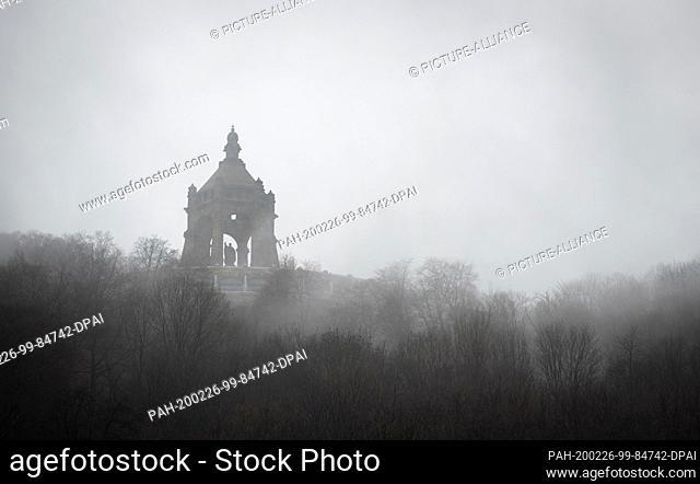 26 February 2020, North Rhine-Westphalia, Porta Westfalica: The approximately 88-metre-high Kaiser Wilhelm Monument at Porta Westfalica can be seen behind...