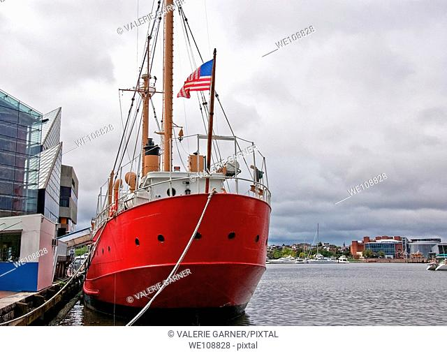 This huge red American ship is docked in a seaport of Balitmore Bay, Maryland while tied to a dock