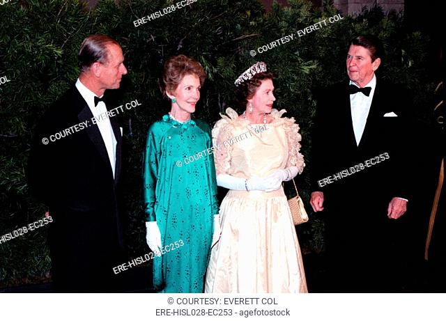 Queen Elizabeth II and Prince Philip stand with President and Mrs. Reagan during a state dinner at the M.H. De Young Museum. March 3 1983