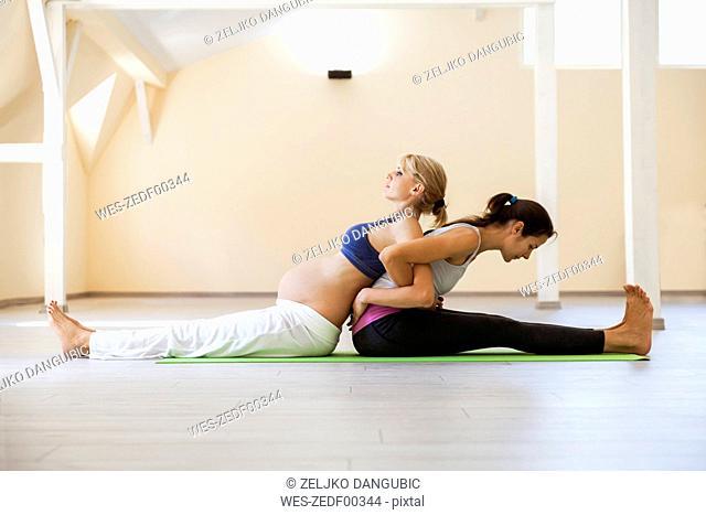 Prenatal yoga, female yoga instructor, stretching