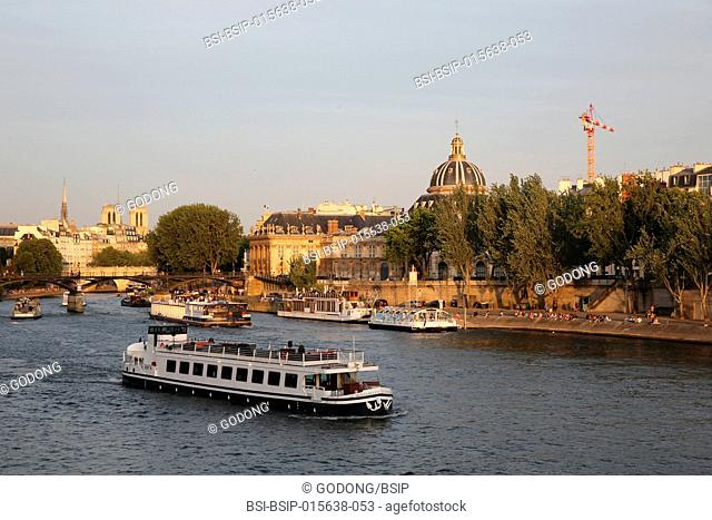 Tourist boat on the Seine river in Paris, France