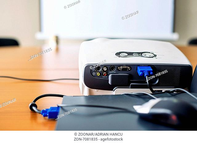 Projector connected to laptop in presentation room