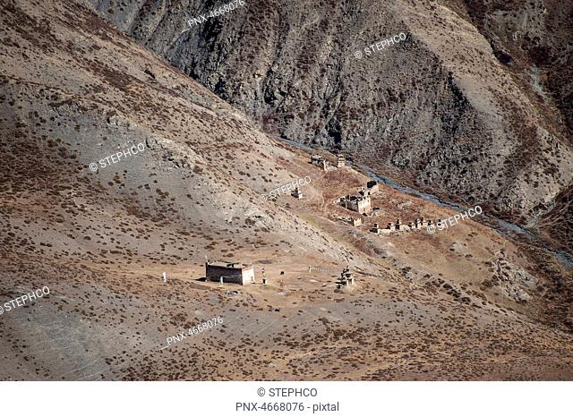 """Gompa and ch""""rten sticked to the mountain, Dolpo, Nepal"""