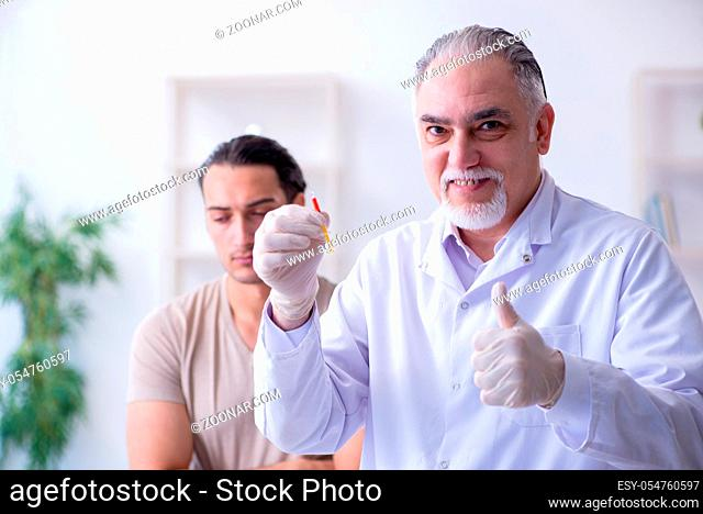 The male patient visitng doctor for shot inoculation