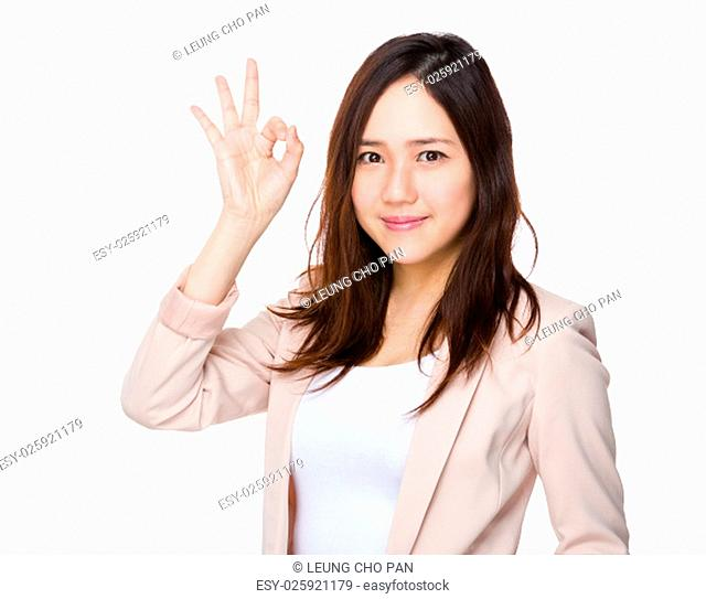 Young Businesswoman showing ok sign gesture