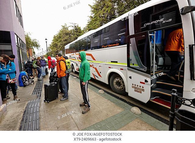 tourists boarding long distance coach bus service Punta Arenas Chile