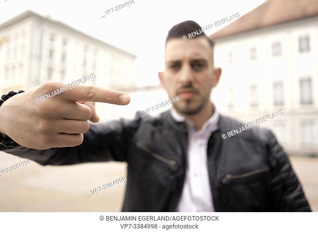 illiberal man, gesture