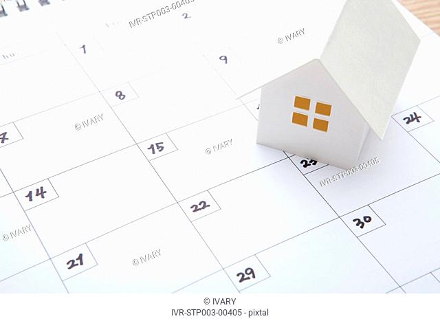 Close-up Of Calendar With House